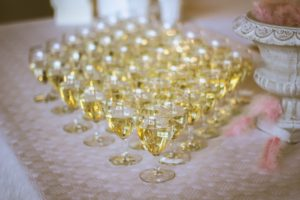 White wine glasses filled on a table